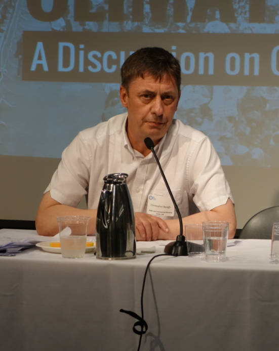 Chris Baugh (Assistant General Secretary, PCS, UK) facilitates a panel on the connection between the climate fight and the struggle against austerity and inequality in southern Europe.